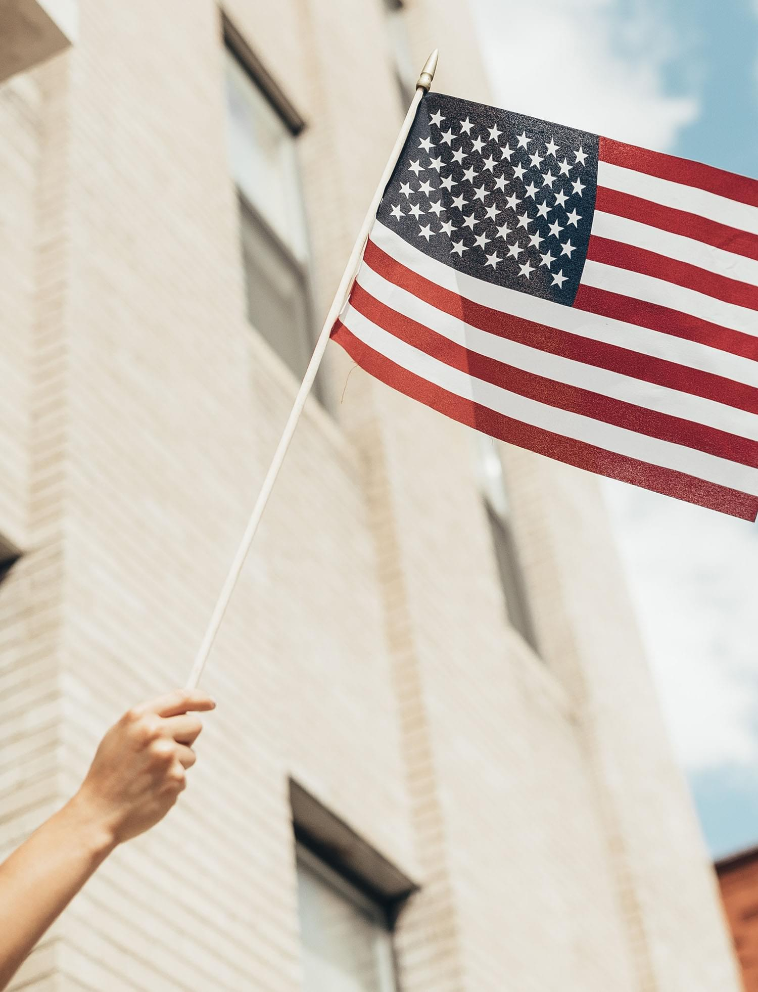 An arm holding the American flag