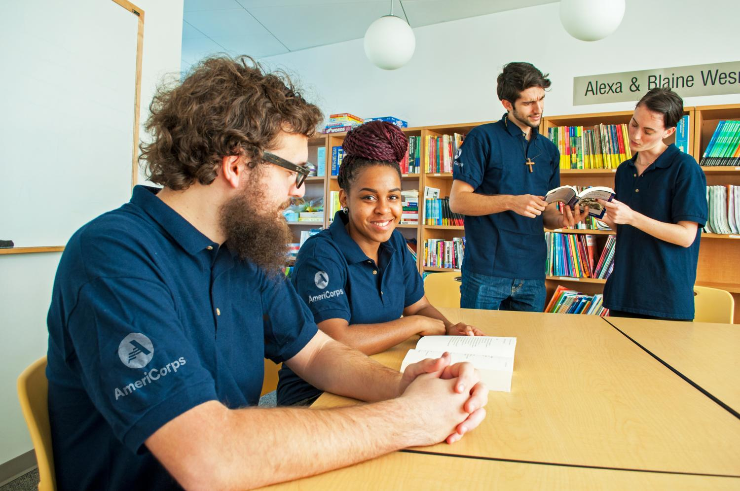AmeriCorps members in library