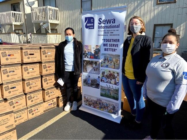 AmeriCorps members serving with Sewa International host a food drive.