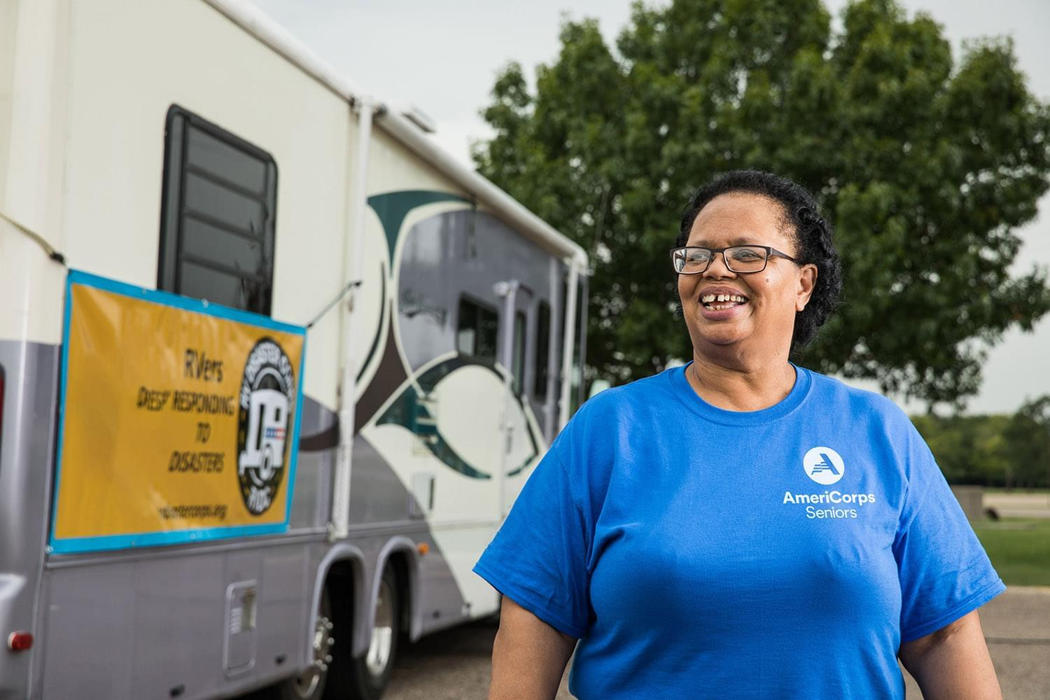 Woman wearing a blue AmeriCorps T-shirt